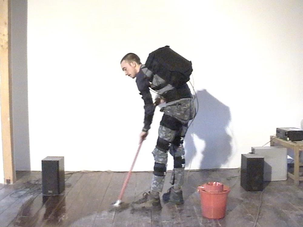 "Wearable Sound: washing the floor of tranzit house, video (3'25""), 2004, video still"